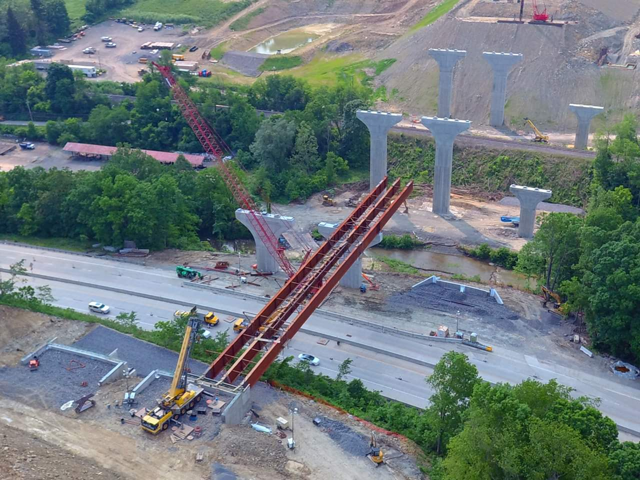 Steel girder erection is underway on the 55C1-1 section of the PA turnpike Southern Beltway